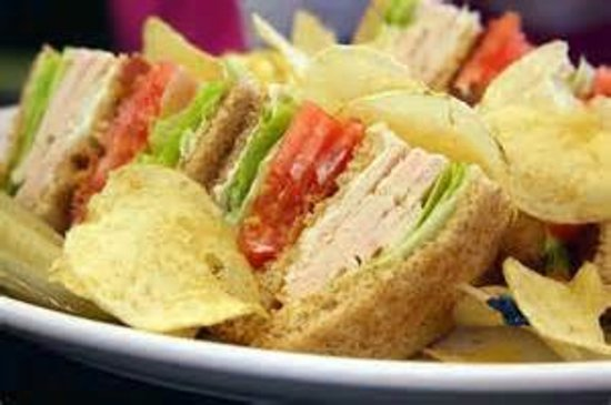 Eufaula, OK: Delicious Club Sandwich served with Chips & Pickle!