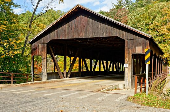 Mohican Lodge and Conference Center: Covered bridge in the park - one of the neat sights in the state park and close to the lodge.