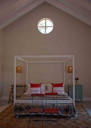 Haenertsburg, Sydafrika: The Loft, King size four poster bed.