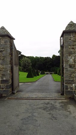 Menai Bridge, UK: The entrance to the Hidden Gardens with the formal lawns in view