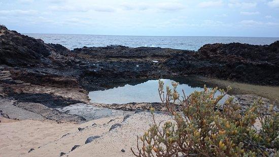 Mala, España: это природный бассейн при отливе