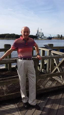 Cape Fear River: Yours truly on the boardwalk with the Battleship USS North Carolina in the background, 17 Nov 15