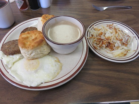 Madisonville, TN: Over easy eggs with biscuits, gravy, sausage patties and hash browns