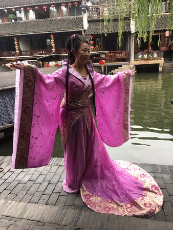 """Jiashan County, China: you can dress up and pose as a """"historical"""" figure - great fun to watch as everyone is VERY seri"""