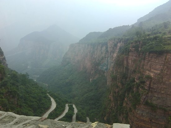 Huixian, China: View down the mountain from the far end of the village.
