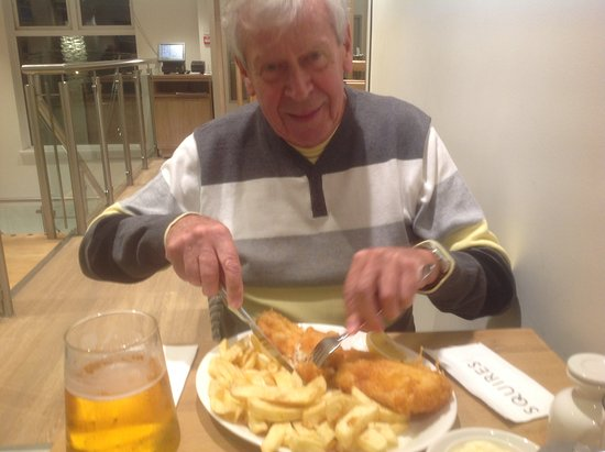 Braunton, UK: My brother, visiting from Canada., enjoying supper at Squires.