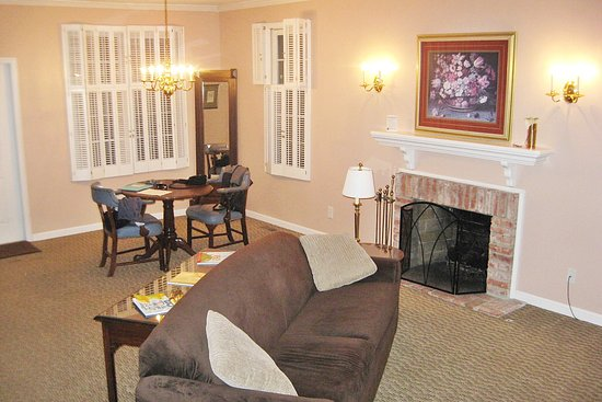Century Suites Hotel Large Living Room With Working Gas Fireplace Dining Area Kitchen