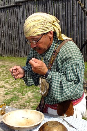 Pine City, MN: Living history interpretor demonstrates the fire making process.