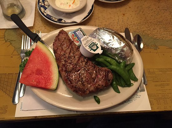 Inverness, FL: New York strip with baked potato
