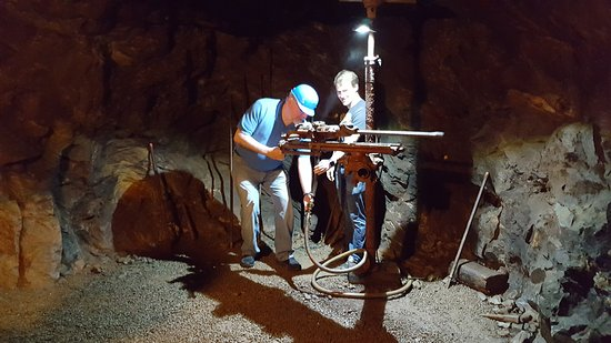 Dahlonega, GA: My husband trying out the drilling machine down in the mine