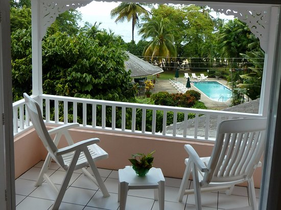 """Plantation Beach Villas: View from upstairs bedroom """"Poinciana Villa"""" overlooking pool and beach bar"""