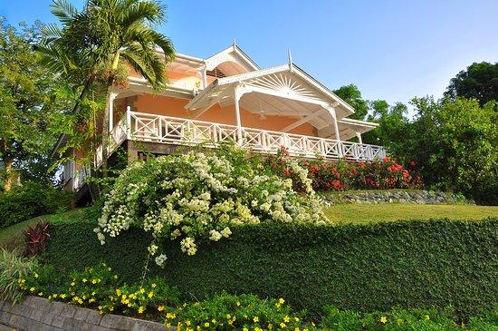 "Plantation Beach Villas: Villa ""Petrea"" with its beautiful bougainvillea and wide verandah"
