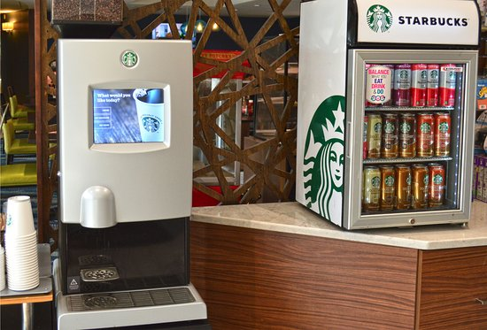 Maplewood Suites Extended Stay: On Demand Starbucks Machine & Sundry located in the Lobby