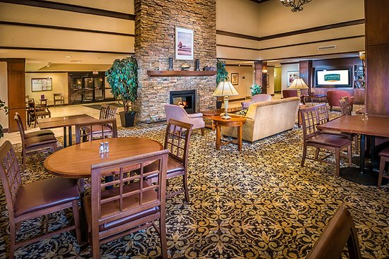 Staybridge Suites Toledo / Maumee: Relax by the fireplace or gather with others in our Greatroom