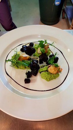 Cullompton, UK : Brixham scallops with our minted pea puree and black pudding