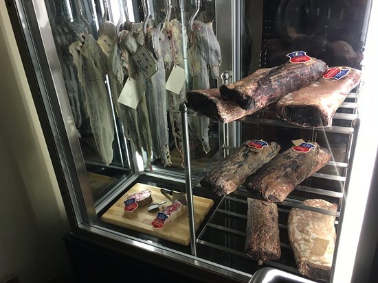 midtown grill dry aging steaks exhibition at the entrance