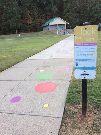 Cumming, GA: There are play ideas for parents and kids painted on walking track