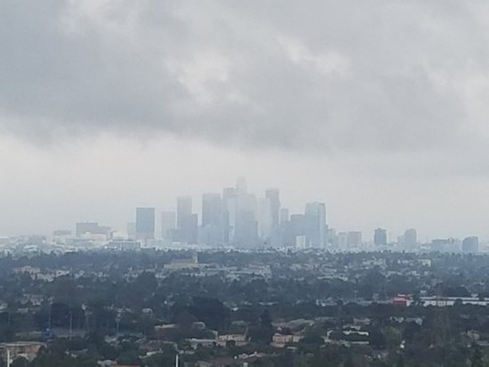 Culver City, CA: Rare rain over downtown LA view from Baldwin Hills Scenic Overlook