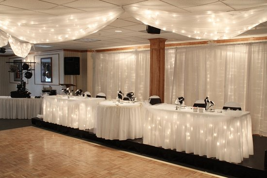 Columbiana, OH: Head table for the wedding party, with draping and lights.