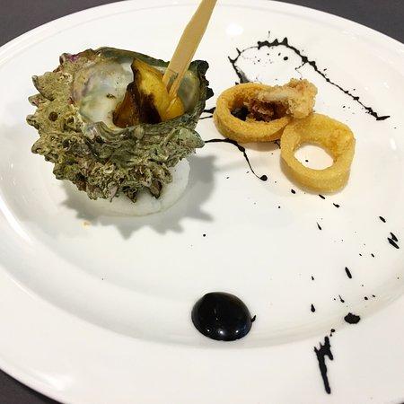 Antipasti Caldi: Fritto sper squid with black aioli sauce & Oven-baked turban shell in garlic bu