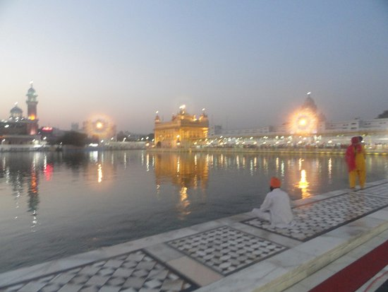 Harmandir Sahib: Early morning view makes the temple even more beautiful, with a reflection of the sky and the te