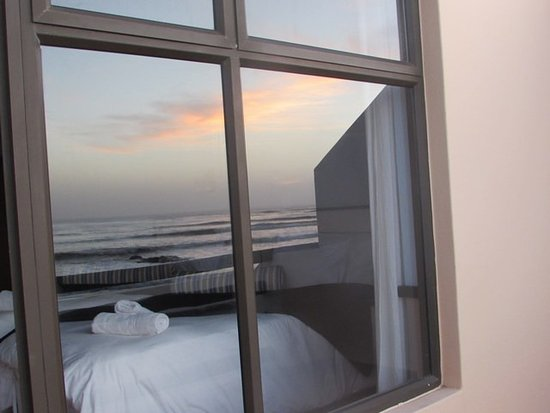 Skeleton Coast Park, Namibia: View of room from balcony with sunset reflected in window