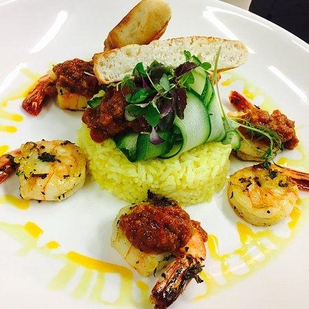 Mornington, Australia: Saute prawns, kasundi sauce, rice pilaf and flat bread.