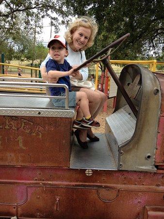 Zilker Zephyr Miniature Train: Old fire truck in Zilker Park.