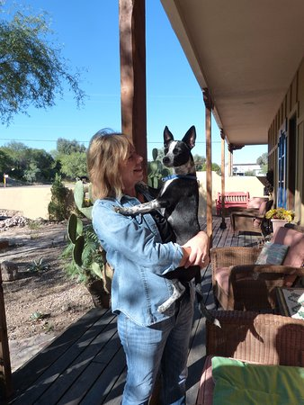 Tubac, AZ: Owner, April with friend, on front porch.