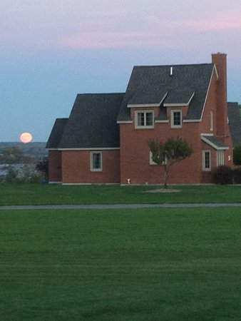 View behind home as the Fall Harvest Supermoon rises above the lake. Just amazing timing for us