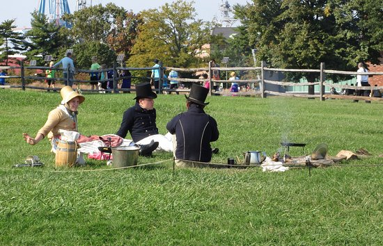 Fort McHenry National Monument: Employees sitting around a cook fire during the Blue Angels Air Show.