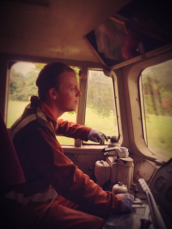 Wirksworth, UK: EVR Diesel Fitter Rob Green at the controls of Class 33 'Swordfish'