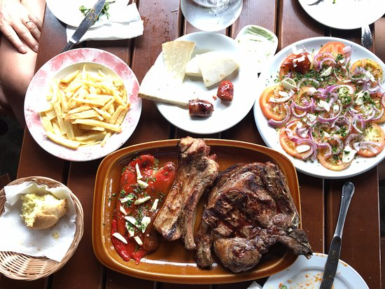Restaurante La Era: For main: T-bone and pork ribs with fries and tomato salad (T-bone, chuleton, ensalada tomate)