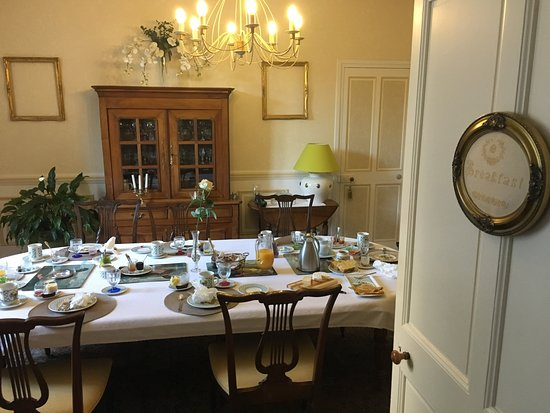 Hotel de Sainte Croix: A classic French breakfast is served elegantly in a room on the first floor.