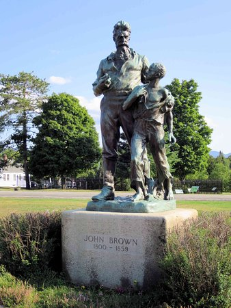 John Brown Farm State Historic Site: Statue of John Brown - with a young man representing the slaves he tried to free