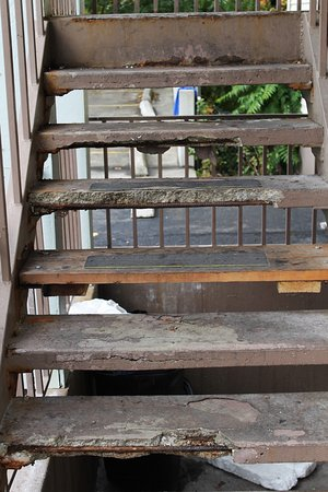 Motel 6: These broken stairs are inviting someone to fall on them.