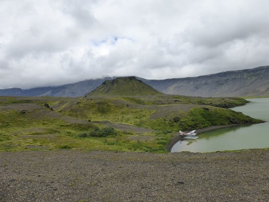 King Salmon, AK: Surprise Lake in caldera of volcano, shows the little plane we flew in