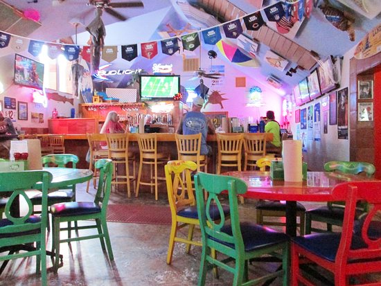 Sanibel Fish House: The Colorful Bar Area With Sports On Several TVu0027s And Tropical  Decor
