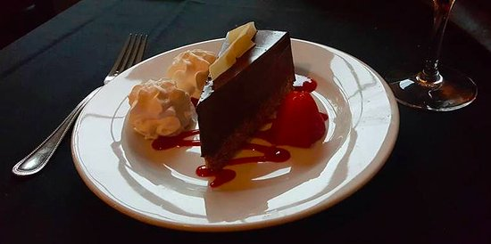 West Kennebunk, ME: Chocolate torte with raspberry coulis, strawberry and whipped cream