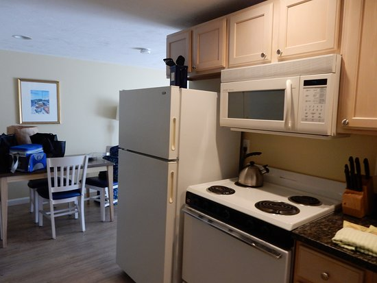 InnSeason Resorts Surfside: kitchen by door dividing bedroom area from living room area