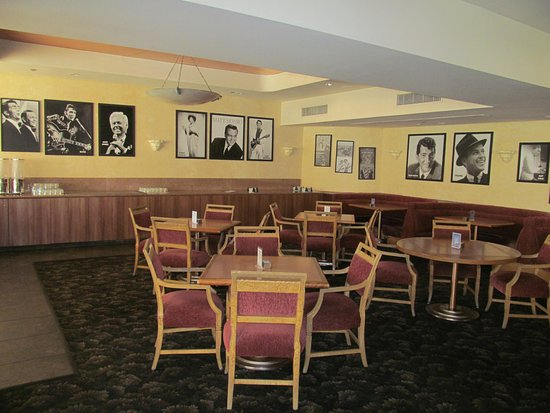 Indian Wells, CA: Dining area quite dated walls lined with entertainers who have passed.
