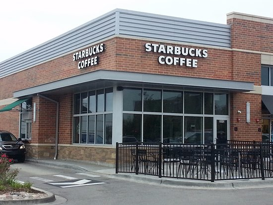 Skokie, IL: Front of, entrance to, outdoor seating area & drive-thru at Starbucks Coffee