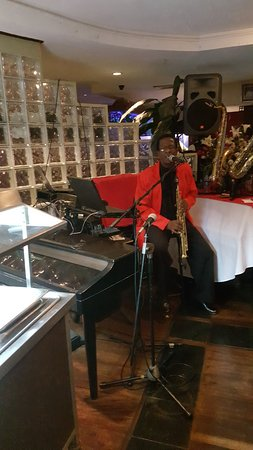 Resident musician at Soong's Great Wall as you dine