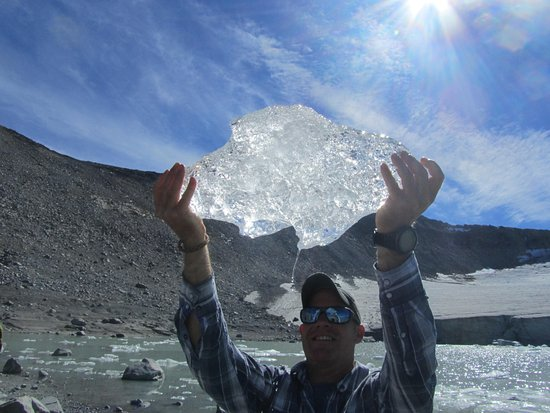Pemberton, Canada: Ben holding up a piece of glacier ice soon to adorn my rye whiskey.
