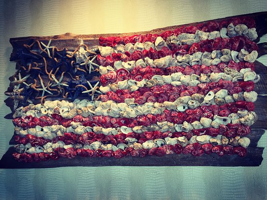 Roswell, GA: American flag made from oyster shells and starfish on driftwood adorns the bar at C&S Chowder Ho