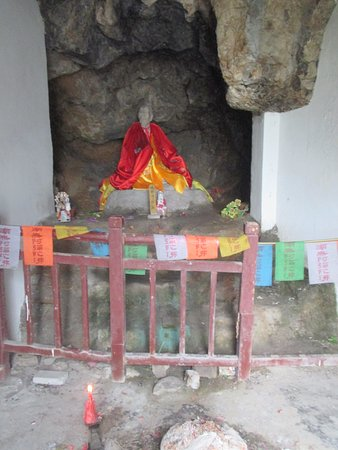 Zhenjiang, China: The statue and signs of worship