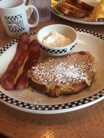 Amore Breakfast: 1)Breakfast combination with bacon, poached eggs, French toast of the day 2) ham and cheese omel