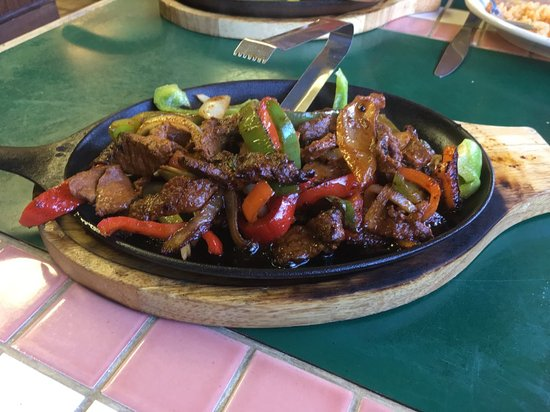 Dolores, CO: Beef fajitas   Seasoned beef, with bell peppers, caramelized onions, on a hot black iron pan