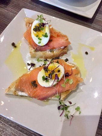 Plover, WI: Smoked salmon toast with capers, cream cheese, & soft boiled egg!  This is SO GOOD!