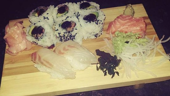 Leigh, UK: duck & cucumber inside-out roll. salmon sashimi. seabass sushi